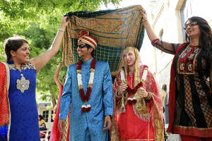 Shaya Kara (from left), Hatim Ezzi, Skylar Ginn, and Pooja Bombaywala perform a bridal parade during the Eid al-Fitr festival.