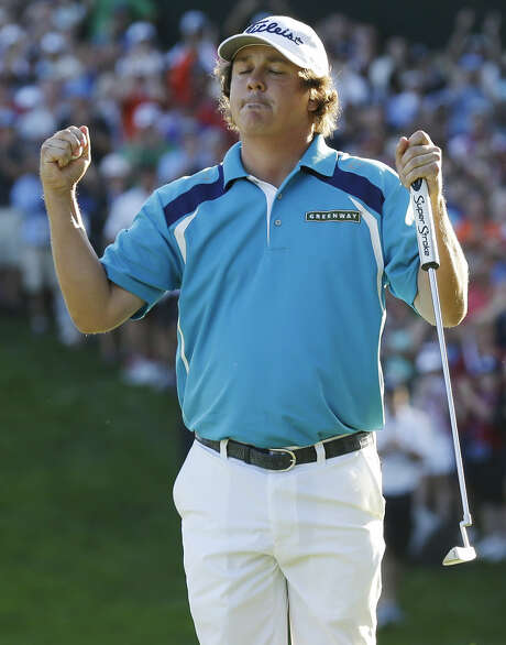 "Jason Dufner savors his first major title with a two-shot victory over Jim Furyk. ""It's a big step in my career,"" Dufner said. Photo: Charlie Neibergall / Associated Press"