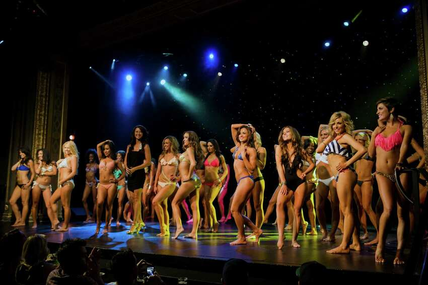 Hundreds packed into The Triple Door to experience the Sea Gals 2014 calendar unveiling event Sunday, August 11, 2013, in Seattle.