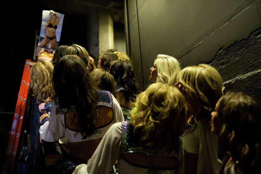 Backstage, the Sea Gals 2014 calendar is unveiled to the squad before the public showing Sunday, August 11, 2013, in Seattle.