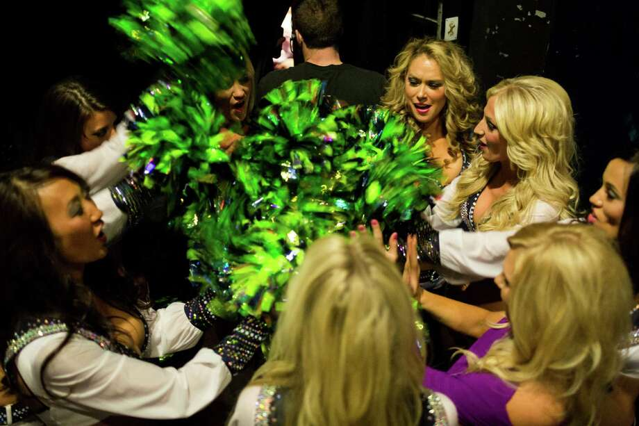 Sea Gals huddle up backstage to wish each other luck before the 2014 calendar unveiling event Sunday, August 11, 2013, in Seattle. Photo: JORDAN STEAD, SEATTLEPI.COM / SEATTLEPI.COM