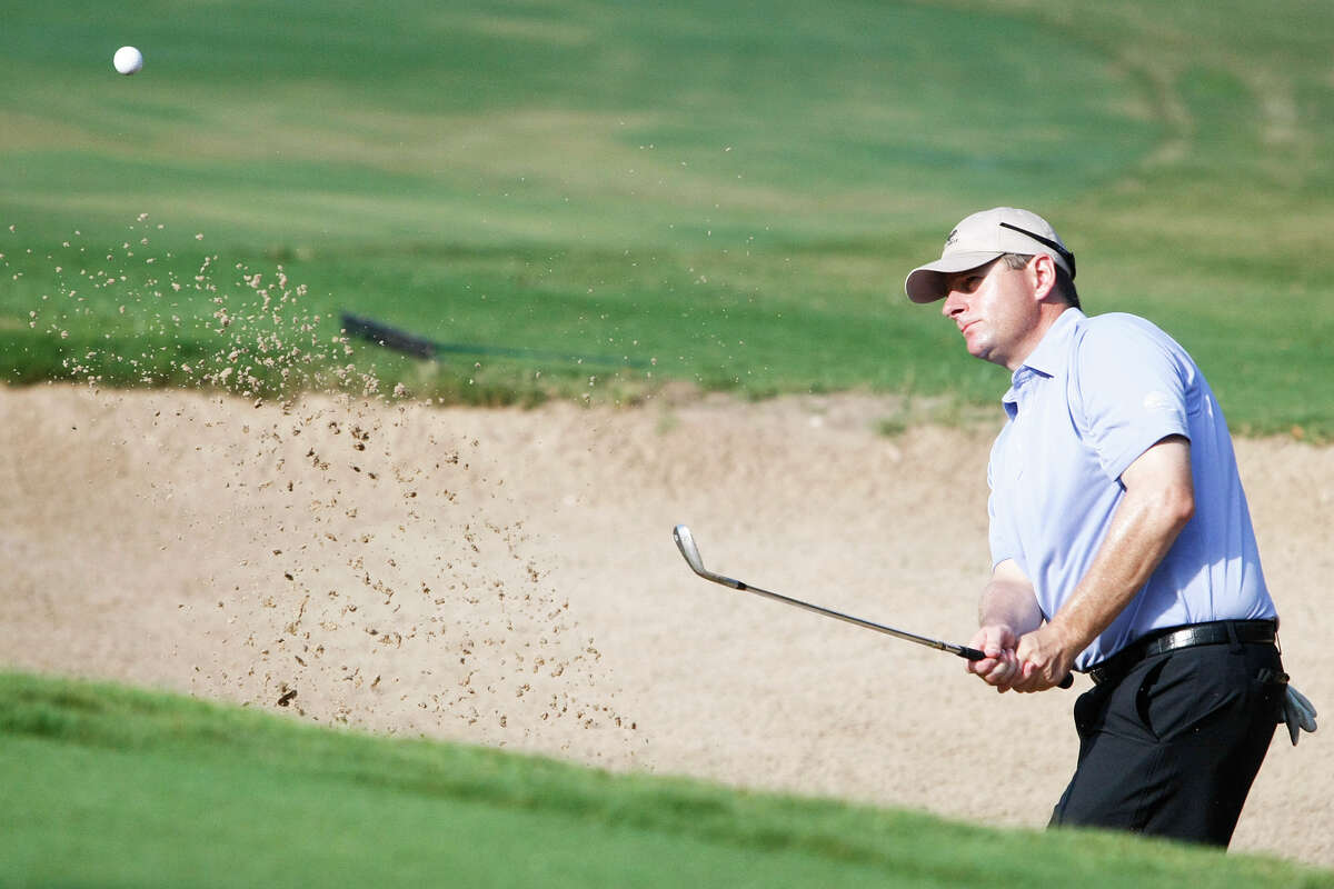 Danny Simmerman hits out a bunker on the 11th hole of his semifinal match with Arnold Martinez during the Greater San Antonio Match Play Championship at Fair Oaks Ranch on Sunday, Aug. 11, 2013. Simmerman defeated Ian Evans 7-and-5 in the final round to win the tournament. MARVIN PFEIFFER/ mpfeiffer@express-news.net