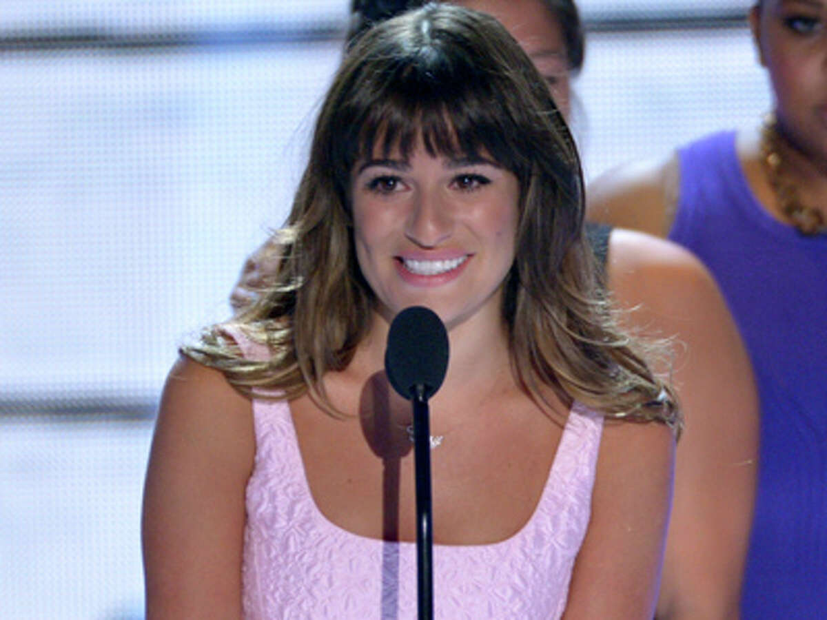 Actress Lea Michele speaks on stage at the Teen Choice Awards at the Gibson Amphitheater on Sunday, Aug. 11, 2013, in Los Angeles.