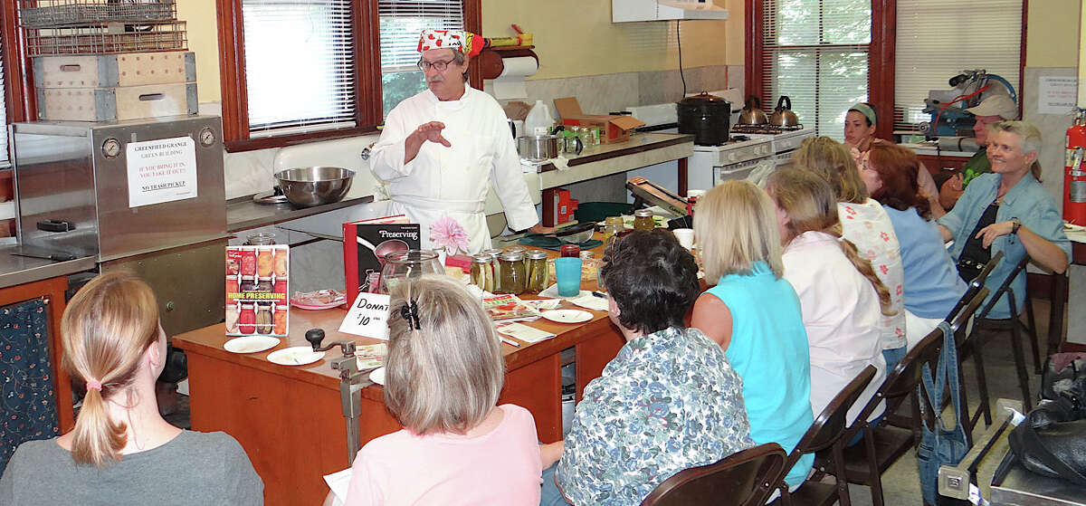 Steven Golias, a Culinary Institute of America graduate, discusses fruit and vegetable canning at a community program sponsored Saturday by the Greenfield Hill Grange.