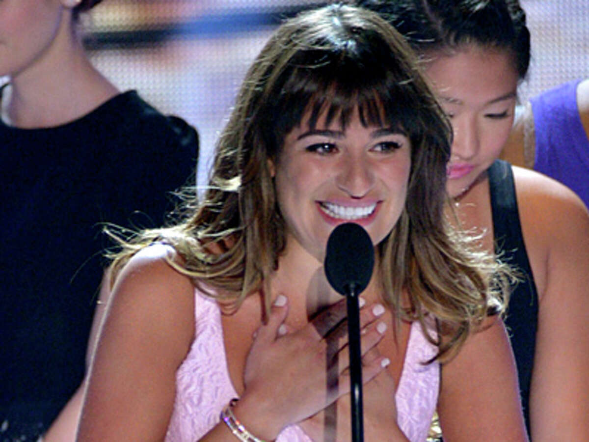Lea Michele speaks on stage at the Teen Choice Awards at the Gibson Amphitheater on Sunday, Aug. 11, 2013, in Los Angeles.