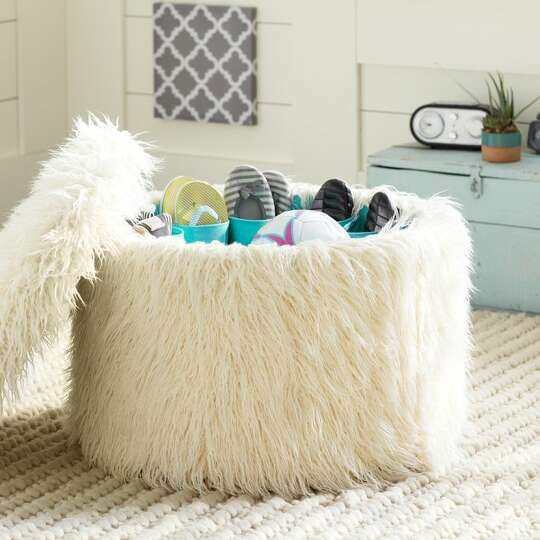 4 A Fuzzy Ottoman Doubles As Extra Shoe Storage 349 At