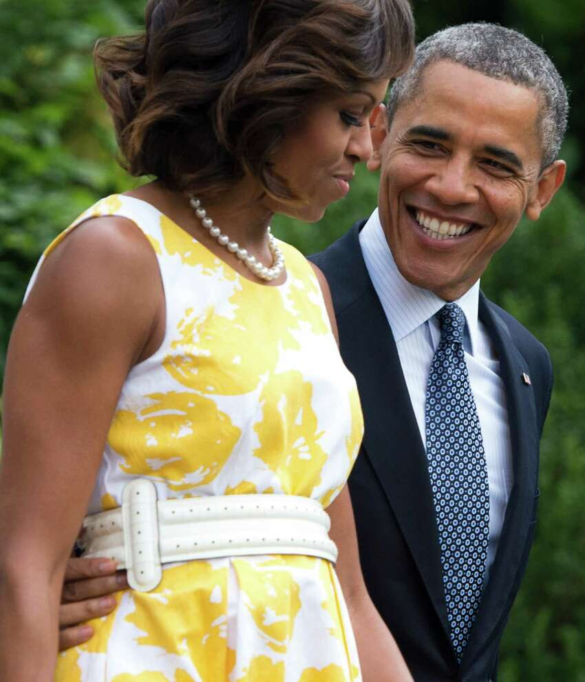 President Barack Obama and First Lady Michelle Obama walk to Marine One prior to departing from the South Lawn of the White House in Washington, DC, August 10, 2013.