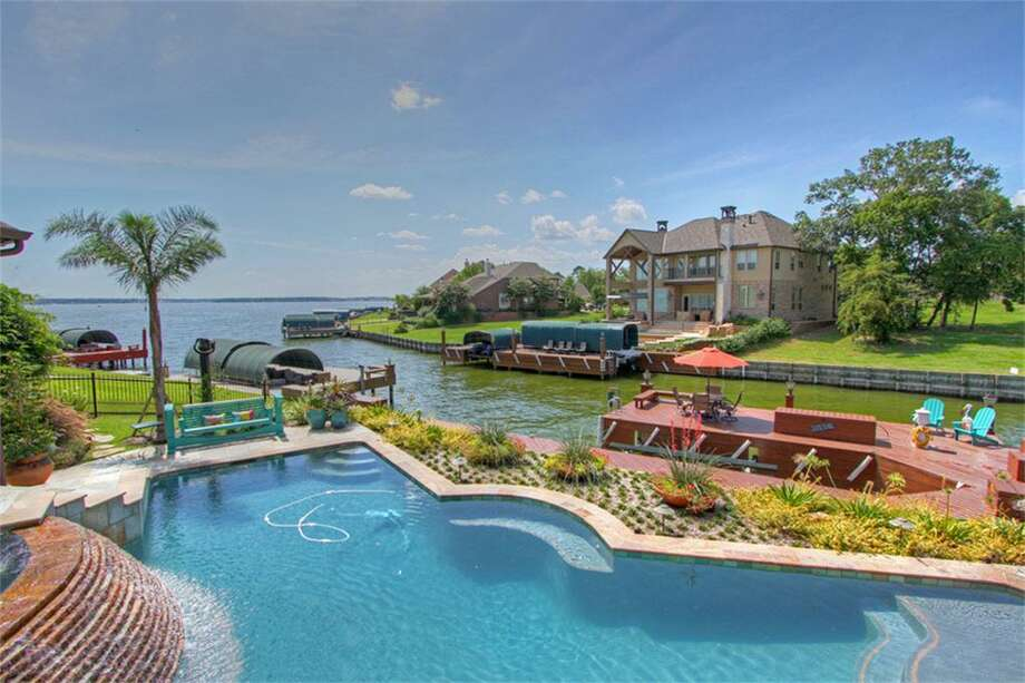 This gorgeous home sits on Lake Conroe and features four bedrooms and three bathrooms in more than 4,700 square feet of living space. The asking price is $1.4 million.See the listing here.