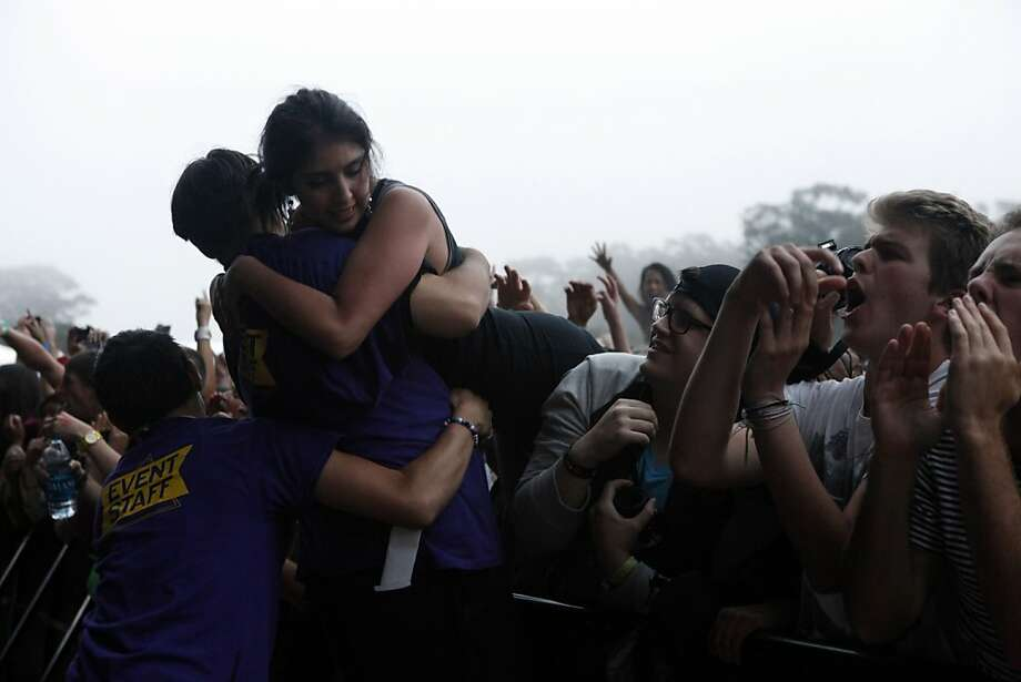 Security pulls a fan who was sitting on someone's shoulders out of the crowd during the Red Hot Chili Peppers perform at the Outside Lands Festival in San Francisco, Calif. on Sunday, August 11, 2013. Photo: Katie Meek, The Chronicle