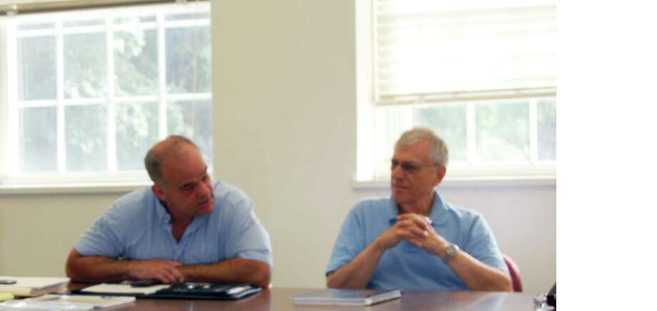 Planning and Zoning Commission member Chip Stephens, left, and Dan Kail, a member of the Downtown 2020 Committee, during a meeting to discuss the finalists to prepare a master plan for the town's central area. Photo: Cameron Martin / Westport News