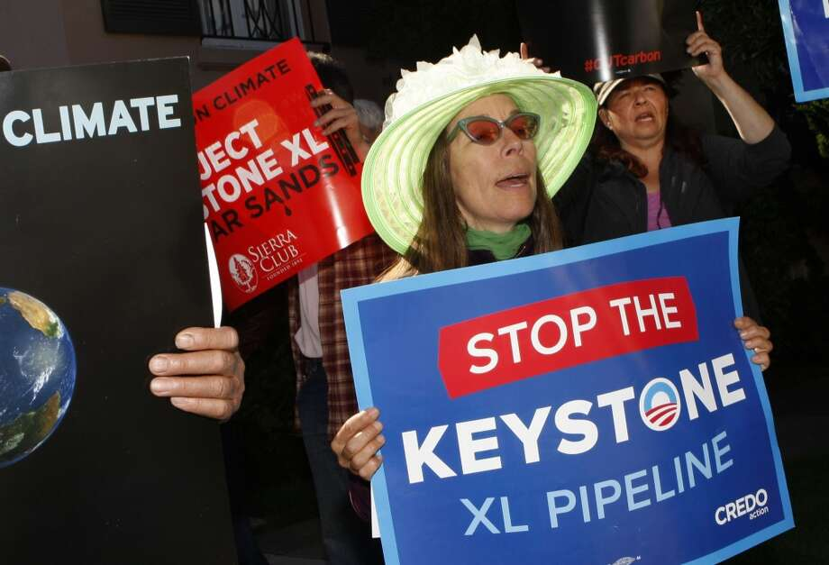 Protesters against the Keystone XL tar sands pipeline including Cat Bell (middle) wait for the arrival of Vice President Joe Biden visiting for a fundraiser in San Francisco , Calif., on Friday, June 14, 2013. Photo: Liz Hafalia, The Chronicle
