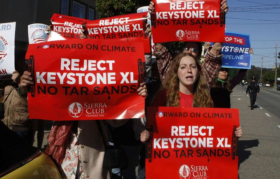 Protesters against the Keystone XL tar sands pipeline including Molly Helfend (left) wait for the arrival of Vice President Joe Biden visiting for a fundraiser in San Francisco , Calif., on Friday, June 14, 2013. Photo: Liz Hafalia, The Chronicle