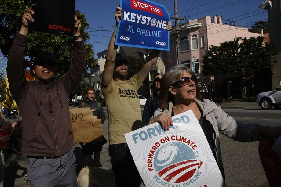 Protesters against the Keystone XL tar sands pipeline wait for the arrival of Vice President Joe Biden visiting for a fundraiser in San Francisco , Calif., on Friday, June 14, 2013. Photo: Liz Hafalia, The Chronicle