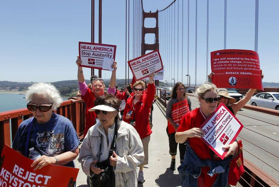 Hundreds of protesters make their way across the Golden Gate Bridge in San Francisco, Calif. on Thursday June 20, 2013. National Nurses United and environmentalists march on the Golden Gate Bridge to protest the Keystone XL pipeline. Photo: Michael Macor, The Chronicle