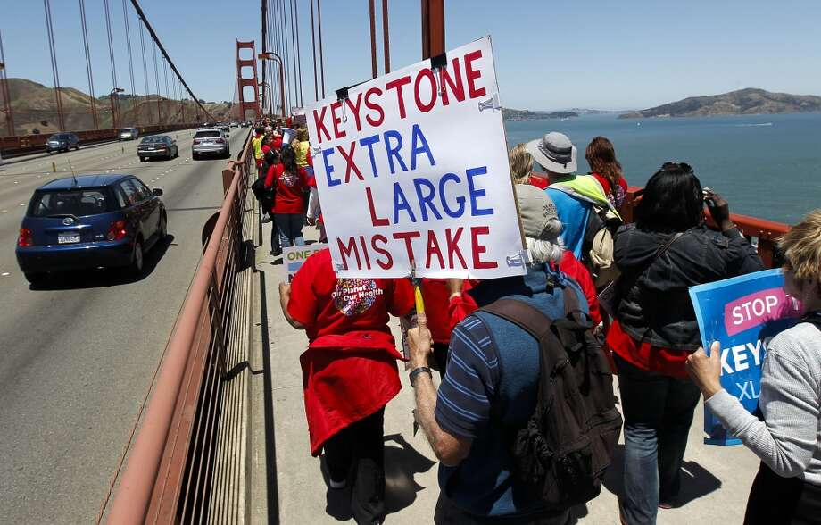 John Hauf of Fairfax, (center) joins hundreds of protesters as they make their way across the Golden Gate Bridge in San Francisco, Calif. on Thursday June 20, 2013. National Nurses United and environmentalists march on the Golden Gate Bridge to protest the Keystone XL pipeline. Photo: Michael Macor, The Chronicle