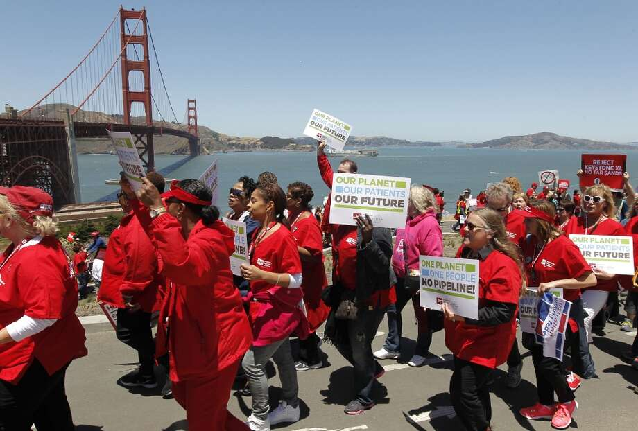 Hundreds of protesters make their way up to the Golden Gate Bridge in San Francisco, Calif. on Thursday June 20, 2013. National Nurses United and environmentalists march on the Golden Gate Bridge to protest the Keystone XL pipeline. Photo: Michael Macor, The Chronicle