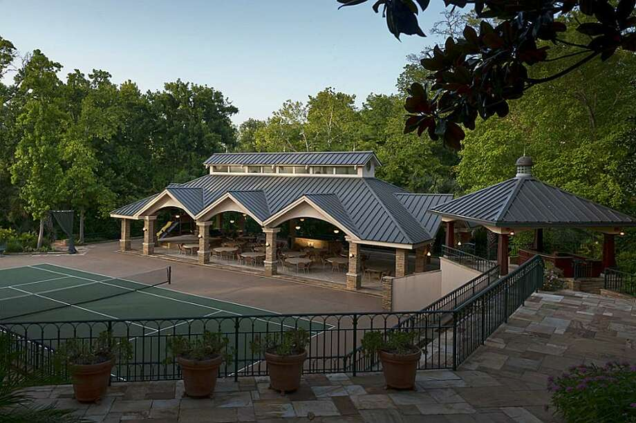 The large estate also features a tennis court with covered seating. The asking price is $14.5 million.See the listing here.