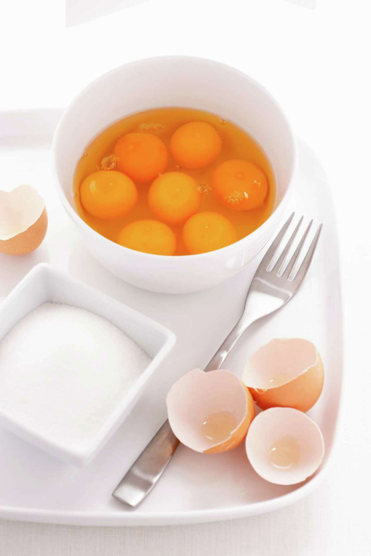 1928 -- albumen - the part of the inside of an egg that is clear before it is cooked and white after it is cooked : the white of an egg