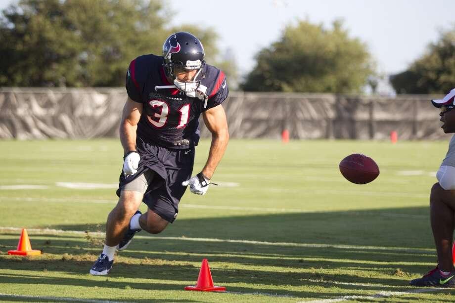 Defensive back Shiloh Keo (31) runs a drill. Photo: Brett Coomer, Chronicle