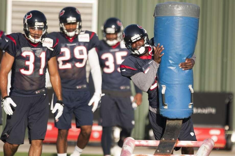 Cornerback Johnathan Joseph hits a blocking sled. Photo: Brett Coomer, Chronicle