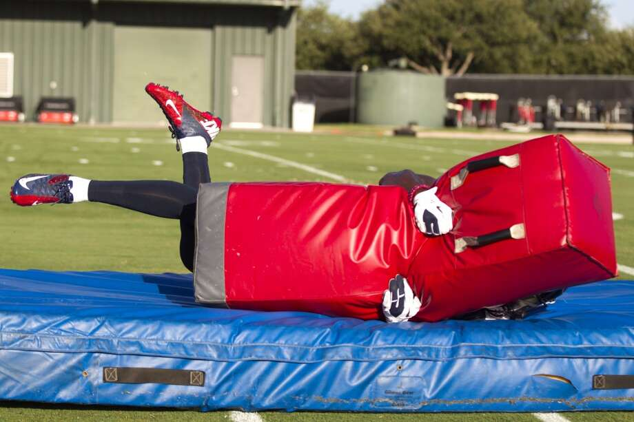 Free safety Danieal Manning hits a tackling dummy. Photo: Brett Coomer, Chronicle