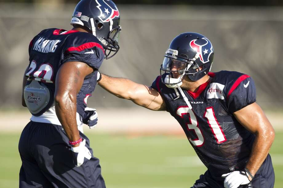 Defensive backs Danieal Manning (38) and Shiloh Keo (31) run a drill. Photo: Brett Coomer, Chronicle