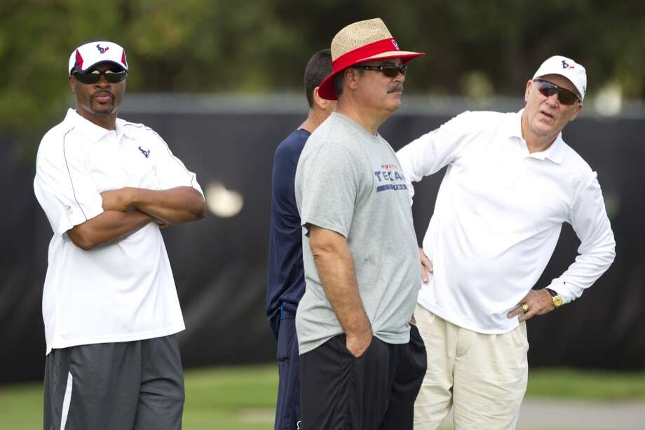 General manager Rick Smith, left, Cal McNair, Texans COO, and owner Bob McNair watch practice. Photo: Brett Coomer, Chronicle