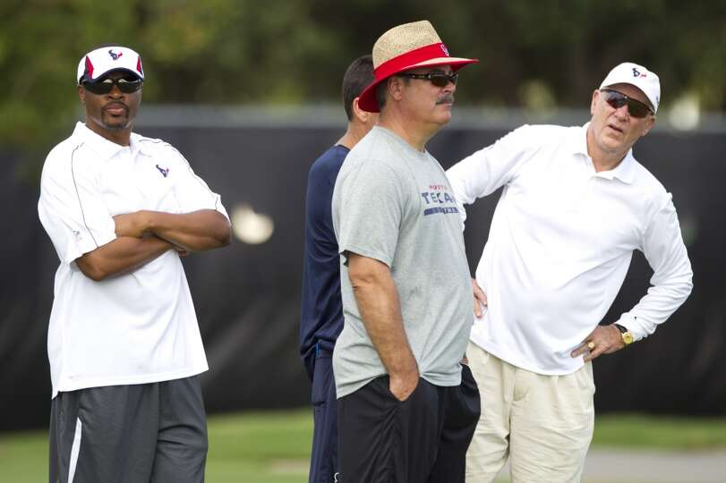 General manager Rick Smith, left, Cal McNair, Texans COO, and owner Bob McNair watch practice.