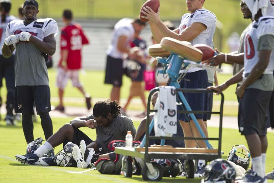 Wide receiver Keshawn Martin, seated, takes a break after practice. Photo: Brett Coomer, Chronicle