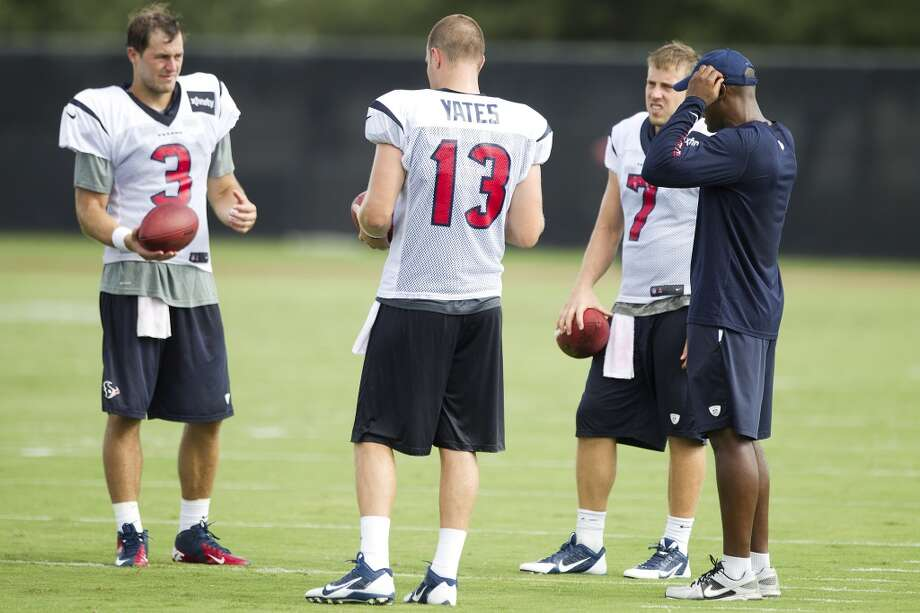 Quarterbacks Stephen McGee (3), T.J. Yates (13) and Case Keenum (7) talk to quarterbacks coach Karl Dorrell after practice. Photo: Brett Coomer, Chronicle