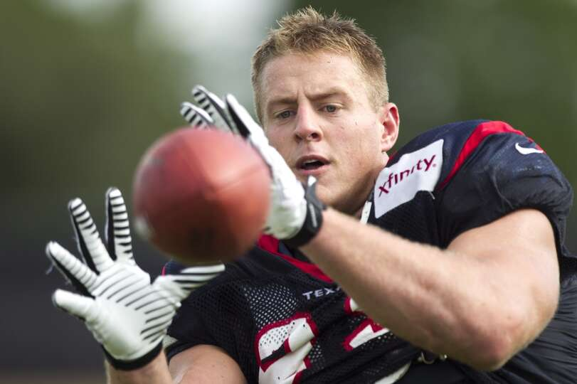 Defensive end J.J. Watt catches a football.