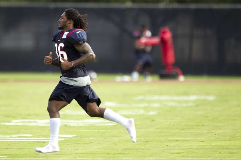 Safety D.J. Swearinger runs across the field after practice.