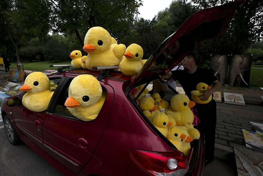 Quacks on, quacks off:A vendor corners the soft toy duckling toy market in Beijing. Photo: Ng Han Guan, Associated Press