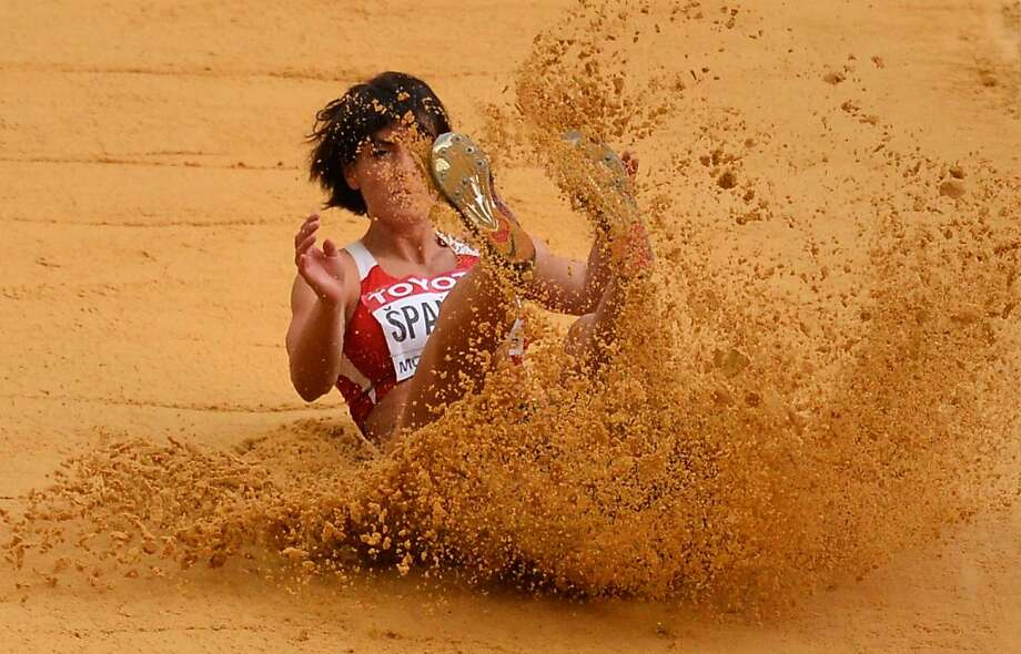 Bronze landing: Serbia's Ivana Spanovic kicks up sand in the long jump final at the IAAF World 