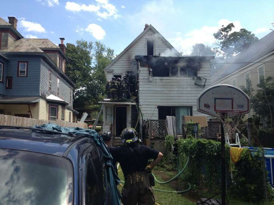 Fire at 1139 Parkwood Blvd. in Schenectady, Monday, Aug. 12, 2013. (John Carl D'Annibale/Times Union)