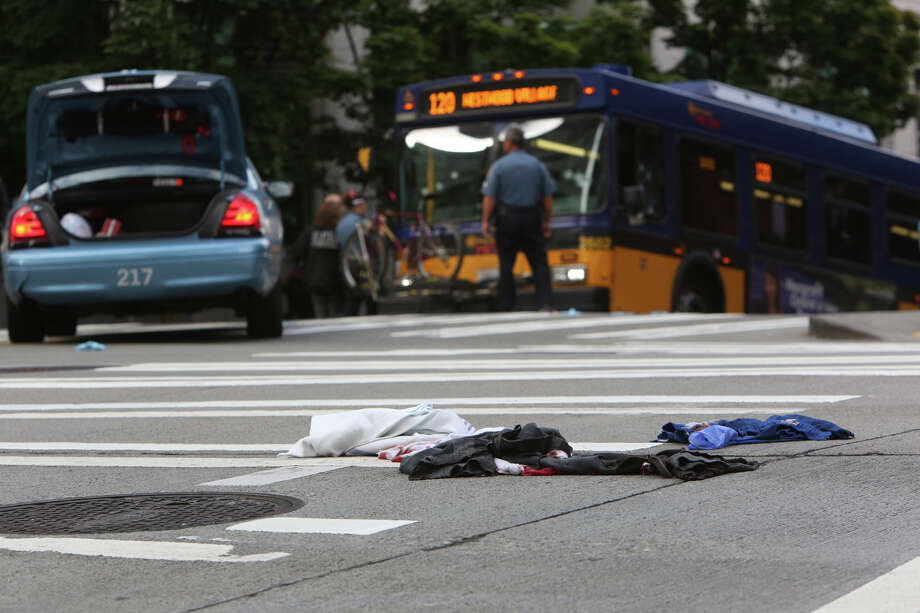 Bloodied clothes are near a bullet-riddled bus where police shot a suspect after the man shot a King County Metro bus driver. T Photo: JOSHUA TRUJILLO, SEATTLEPI.COM / SEATTLEPI.COM