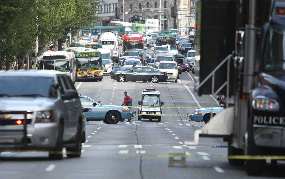 Traffic is backed up on Second Avenue after a man shot a King County Metro bus driver. Seattle police shot the suspect as as he fled into a second bus during the morning rush hour.  Photo: JOSHUA TRUJILLO, SEATTLEPI.COM / SEATTLEPI.COM