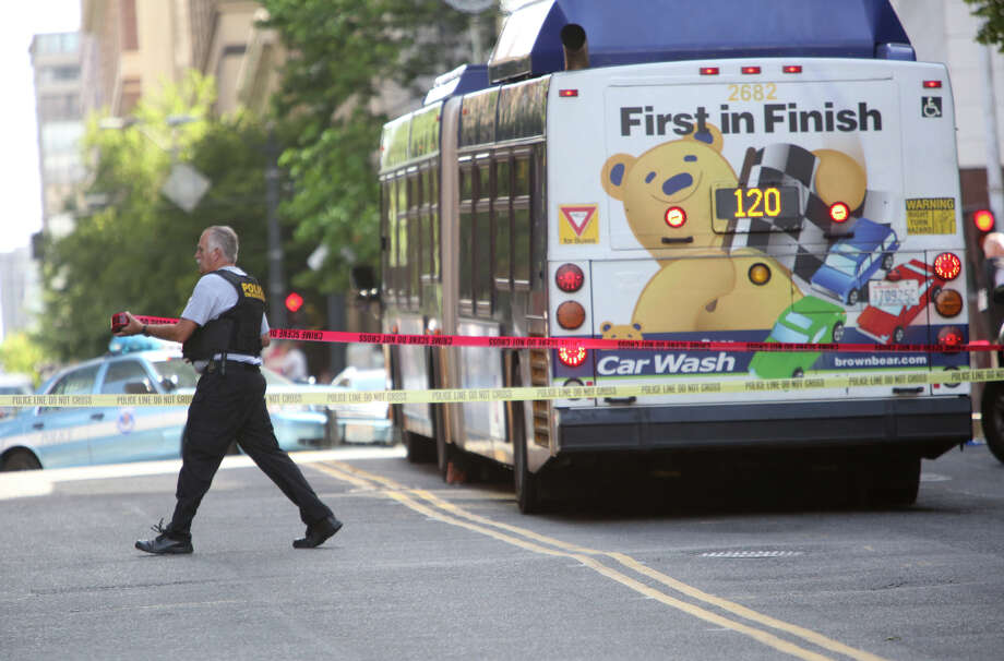 Crime-scene tape is placed around a bullet-riddled bus where police shot a suspect after the man shot a Metro driver. T Photo: JOSHUA TRUJILLO, SEATTLEPI.COM / SEATTLEPI.COM