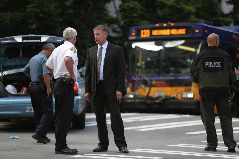 Interim Seattle Police Chief Jim Pugel, center, looks over a bullet-riddled bus. Photo: JOSHUA TRUJILLO, SEATTLEPI.COM / SEATTLEPI.COM