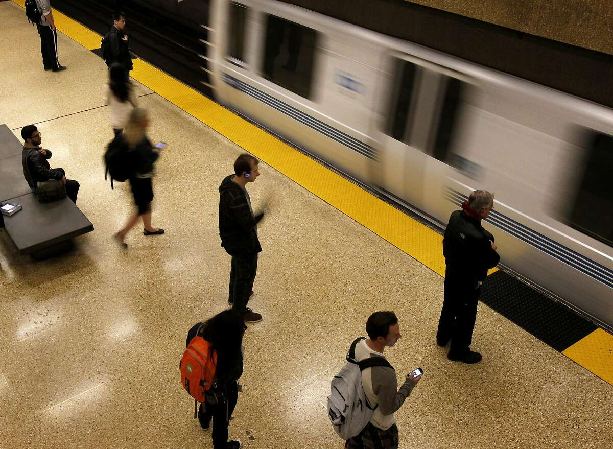 Passengers are seen waiting for a San Francisco bound train at the downtown Berkeley BART station. A person became trapped under a train Sunday, December 20, 2015, closing the station.