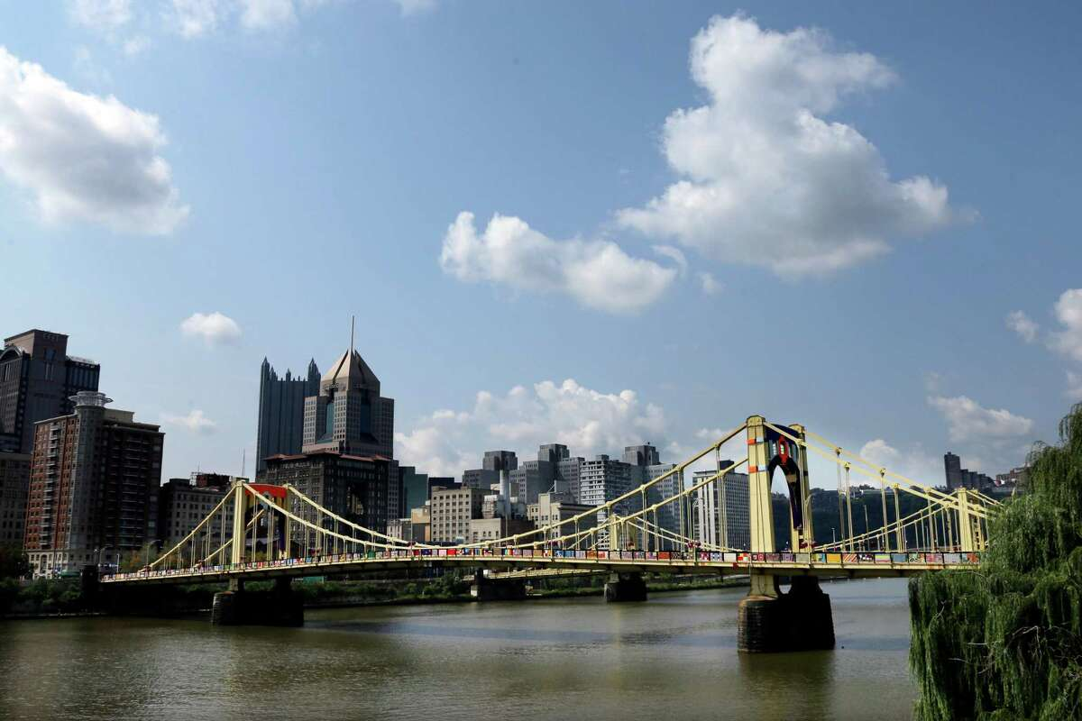This is the Andy Warhol bridge on Monday, Aug. 12, 2013, in downtown Pittsburgh after more than 1,800 knitters covered the bridge in 3,000 feet of colorful yarn. Volunteers worked all weekend to attach 580 blanket-sized, hand- knitted panels to the pedestrian walkways. (AP Photo/Gene J. Puskar) ORG XMIT: PAGP102