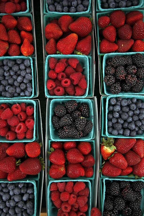 Fresh berries are among the wares available at the farmers' market in the coastal town of Aptos. The market is one of the oldest and most interesting in California. Photo: Preston Gannaway, Special To The Chronicle