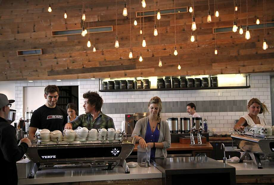 Baristas are busy behind the counter, preparing drinks at Verve Coffee Roasters in downtown Santa Cruz, one of three Verve locations in the college town. Photo: Preston Gannaway, Special To The Chronicle
