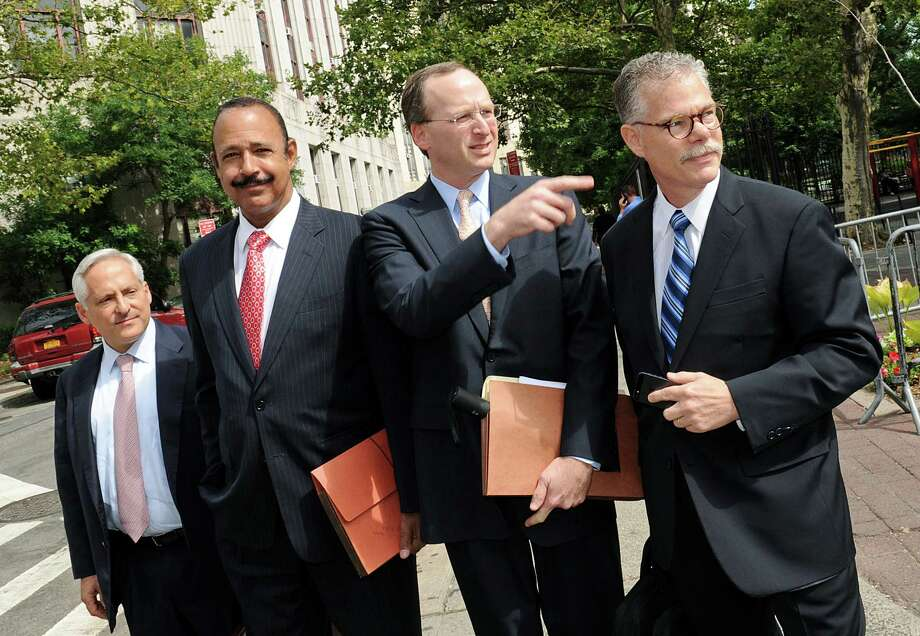 Attorneys representing SAC Capital Advisors LP, from left, Michael Gertzman, Ted Wells, Peter Nussbaum, general counsel for SAC, and Daniel J. Kramer, walk outside federal court in New York, U.S., on Friday, July 26, 2013. SAC pleaded not guilty to all charges by U.S. prosecutors of running an alleged insider trading scheme, Nussbaum said in federal court today. Photo: Peter Foley, Peter Foley/Bloomberg / Stamford Advocate contributed