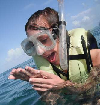 My daughter holding a starfish.  While snorkeling the barrier reef off of Belize. this was a few years ago, but is still one of our favorite pictures.