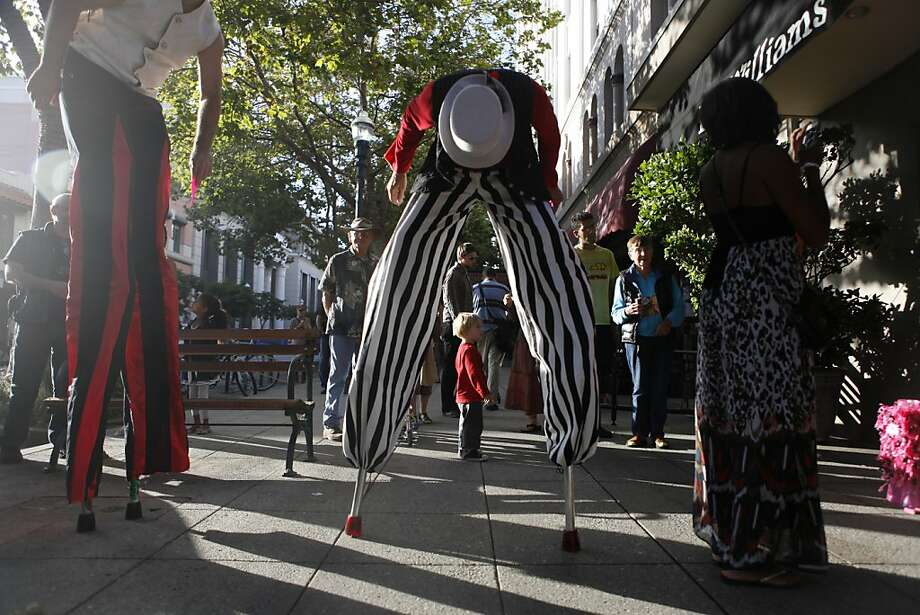 Santa Cruz First Friday is expanding beyond the visual arts and drawing people downtown to take in the stilt walkers, musicians and even business openings. Photo: Katie Meek, The Chronicle