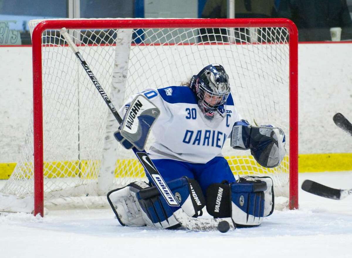 Darien's Katharine Macomber makes a save during a girls hockey game against New Canaan in Darien, Conn. on Wednesday, Jan. 20, 2010
