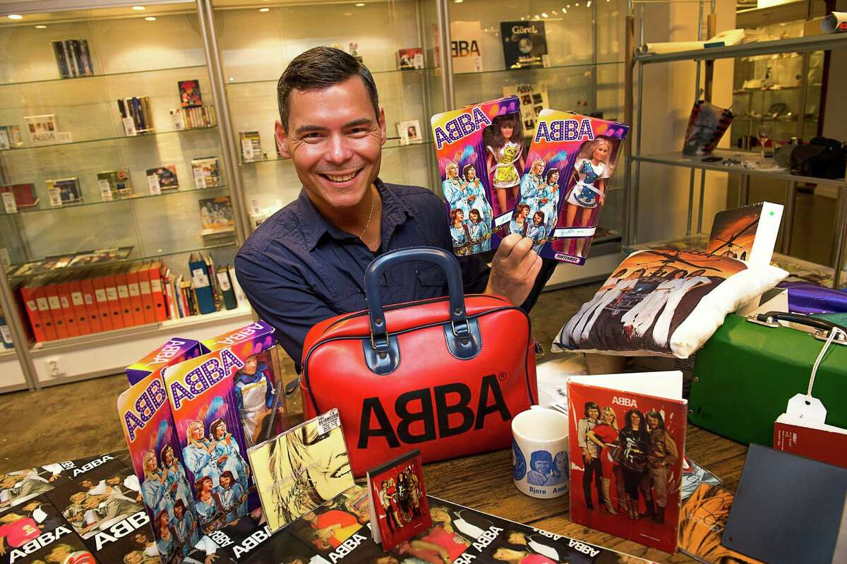 FILE- File photo from June 26, 2013, that shows Tomas Nordin among some of the 25,000 items in his ABBA collection that were sold at Stockholm auction house over the weekend of 10-11 Aug. 2013. Stockholm's Auktionsverk on Monday said the stash of ABBA items sold for 560,000 Swedish kronor ($86,000) (AP photo / Scanpix Sweden /Jonas Ekstromer) ** SWEDEN OUT ** ORG XMIT: STO101