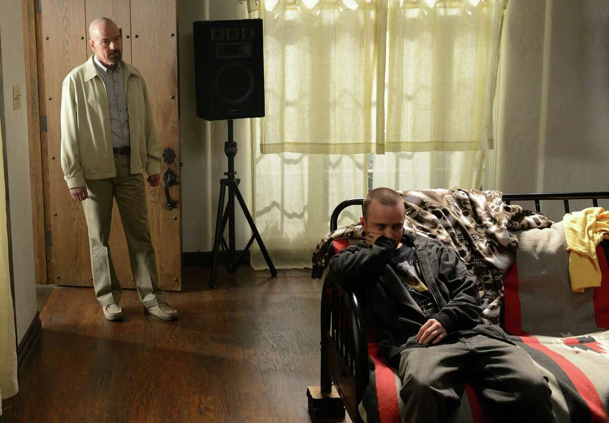 This TV publicity image released by AMC shows Bryan Cranston as Walter White, left, and Aaron Paul as Jesse Pinkman in a scene from