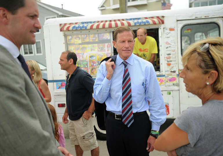 Rep. Jim Himes, left, and Sen. Richard Blumenthal talk with Cooper Avenue homeowner Renee Capece dur